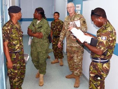 Master Sgt. Joseph Cole (center), from the U.S. Army's Louisiana National Guard's Construction Facility Management Office, and service members from the Belize Defence Force, participate in a site survey and facility assessment exercise of a military hospital in Belize City May 9.