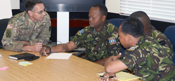 (From left) Capt. James Hoover, U.S. Army Louisiana National Guard; Cpl. Obedio Keh and Capt. Darius Ramos, Belize Defense Force, participate in a table top exercise during an Energy and Water Conservation Policy Subject Matter Expert Exchange in Belize City May 8.