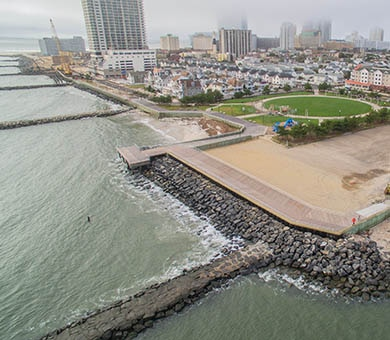 The U.S. Army Corps of Engineers and its contractor  completed the Absecon Inlet seawall and boardwalk project in April of 2018. Work involved building the seawall along two previously unprotected sections of the Atlantic City shoreline and rebuilding the historic boardwalk behind those two sections.