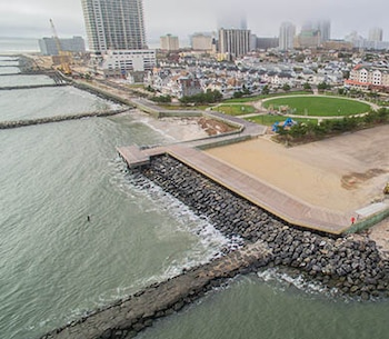The U.S. Army Corps of Engineers and its contractor J. Fletcher Creamer & Son completed the Absecon Inlet seawall and boardwalk project in April of 2018. Work involved building the seawall along two previously unprotected sections of the Atlantic City shoreline and rebuilding the historic boardwalk behind those two sections.