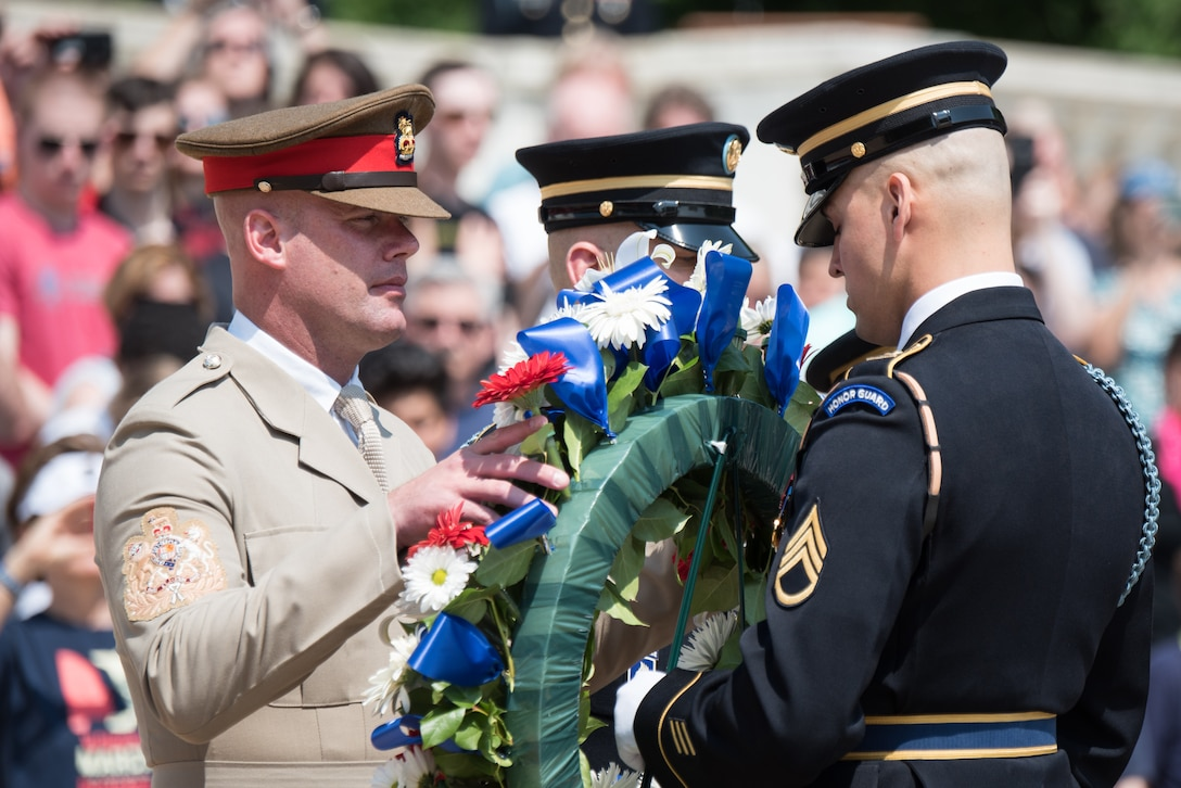U.S. Army Command Sgt. Maj. John W. Troxell, Senior Enlisted Advisor to the Chairman of the Joint Chiefs of Staff, and British Army Warrant Officer Class One Glenn Haughton, Army Sgt. Maj., visit Arlington National Cemetery.