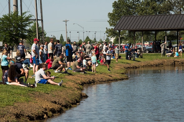 188th Wing members and their families take part in a fishing derby during the 188th Wing's Family Day at Fort Smith, Ark., May 6, 2018. The 188th Wing hosts an annual family day to build morale and camaraderie for wing members and families. (U.S. Air National Guard photo by Tech. Sgt. Daniel Condit)