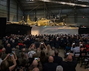The B-17F Memphis Belle is unveiled during a private ceremony on May 16, 2018.