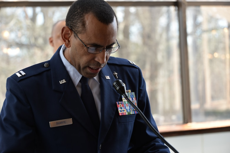 Chaplain (Capt.) Manuel Duarte, 70th Intelligence, Surveillance and Reconnaissance Wing chaplain, provides an invocation prior to a promotion ceremony Feb. 24, 2017, at Fort George. G. Meade, Maryland. Duarte is part of the 2017 Air Force Best Small Chapel team. (U.S. Air Force photo by Staff Sgt. Alexandre Montes)