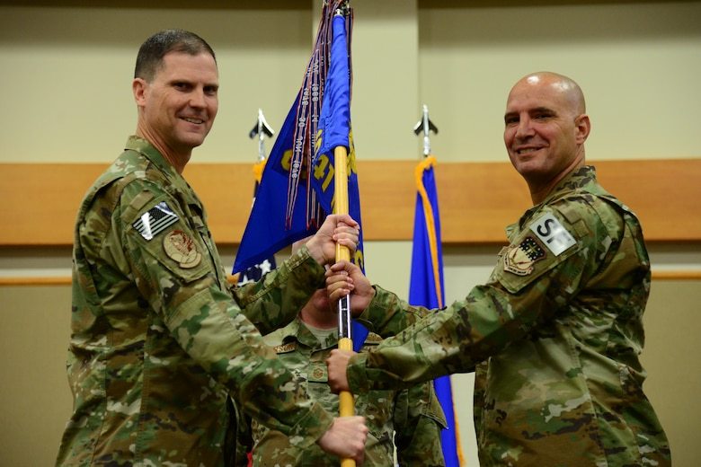 Lt. Col. Kevin Lombardo, right, accepts command of the 341st Missile Security Forces Squadron from Col. Aaron Guill, 341st Security Forces Group commander May 17, 2018, at Malmstrom Air Force Base, Mont.