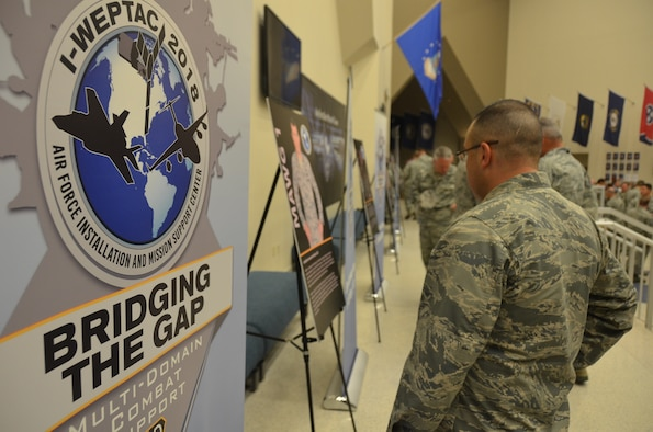 2018 Installation and Mission Support Weapons and Tactics Conference attendees read about one of the four mission area working group chairmen who led a team to think innovatively in tackling one of the Air Force's toughest agile combat support challenges during the San Antonio event out-brief. The May 16 out-brief presented proposed solutions to about 1,000 senior Air Force leaders and members of the installation and mission support community. (U.S. Air Force photo by Armando Perez)