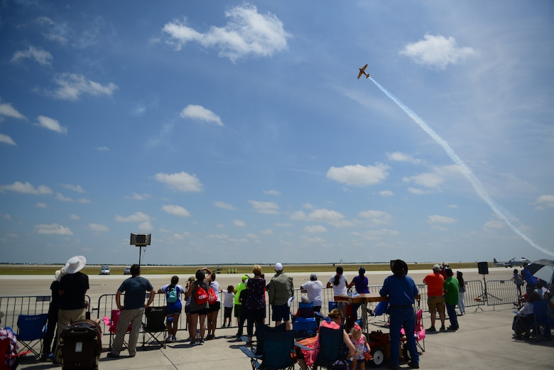"Attendees of Laughlin Air Force Base's open house and airshow, ""Fiesta of Flight,"" watch as a performer navigates the Texas skies, May 12, 2018. With more than 20,000 people in attendance, aircraft from various generations displayed their aerial capabilities. (U.S. Air Force photo by Senior Airman Benjamin N. Valmoja)"