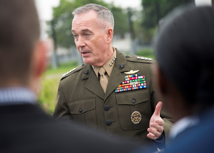 Chairman of the Joint Chiefs of Staff speaks with officers.