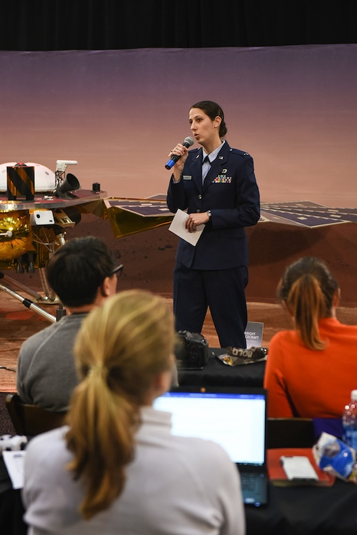 U.S. Air Force 1st Lt. Kristina Williams, 30th Operations Support Squadron launch weather officer, briefs during the National Aeronautics and Space Administration Pre-Launch briefing for the Mars InSight mission on May 5, 2018, Vandenberg Air Force Base, Calif. From prelaunch planning to the launch window of the InSight mission, a majority of the key players and leadership roles were filled by the women of Vandenberg. (U.S. Air Force photo by Michael Peterson/Released)