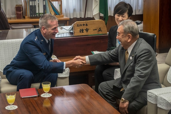 U.S. Air Force Gen. Terrence J. O'Shaughnessy, left, Pacific Air Forces (PACAF) commander, shakes hands with Misawa City Mayor Kazumasa Taneichi, right, during a visit to Misawa Air Base, Japan, at the city office in Misawa City, Japan, May 10, 2018. The general reassured Taneichi of PACAF's commitment to Misawa, recalling his time as commander and the 'two cultures--one community' approach to life in Misawa, which remains in existence today. O'Shaughnessy said strengthening the command's alliances and partnerships is a strategic priority. He added that PACAF's goal is to facilitate enhanced security cooperation and interoperability among allied nations across the Indo-Pacific region. (U.S. Air Force photo by Tech. Sgt. Benjamin W. Stratton)