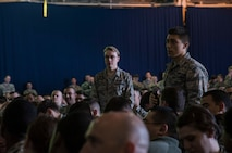 A U.S. Air Force Airman with the 35th Fighter Wing asks Gen. Terrence J. O'Shaughnessy, Pacific Air Forces (PACAF) commander, a question during the general's commander's call at Misawa Air Base, Japan, May 11, 2018. This one-on-one dialogue offered Airmen an opportunity to get answers to questions about the command from PACAF's top leader. (U.S. Air Force photo by Senior Airman Sadie Colbert)