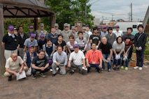 Volunteers from Yokota Air Base, Japan and the city of Fussa, Japan pose for a photo following the closing ceremony on day one of the Fussa Beautification Project in Fussa, May 17, 2018.