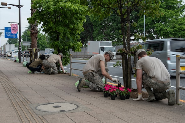 Airmen from the 374th Communications Squadron Operations Flight work with volunteers from the local community to plant flowers for the Fussa Beautification Project outside of Yokota Air Base, Japan in Fussa May 17, 2018.