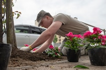 Airman 1st Class Hunter Lobb, 374th Communications Squadron Operations Flight client systems technician apprentice, plants a flower for the Fussa Beautification Project outside of Yokota Air Base, Japan in Fussa May 17, 2018.
