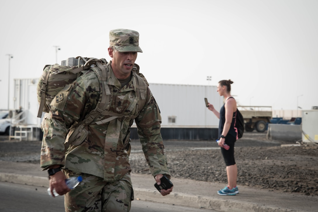Members from Al Dhafra Air Base participate in a 5k run and ruck march in honor of National Police Week on Al Dhafra Air Base, United Arab Emirates, May 18, 2018. Participants carried bricks with names of fallen security forces officers.