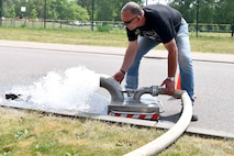 Volker Gehres, water-plant mechanic, 786th CES, flushes out a gutter near a fire hydrant on Ramstein Air Base, Germany, May, 9, 2018. Gehres has worked for the water plant for 15 years.
