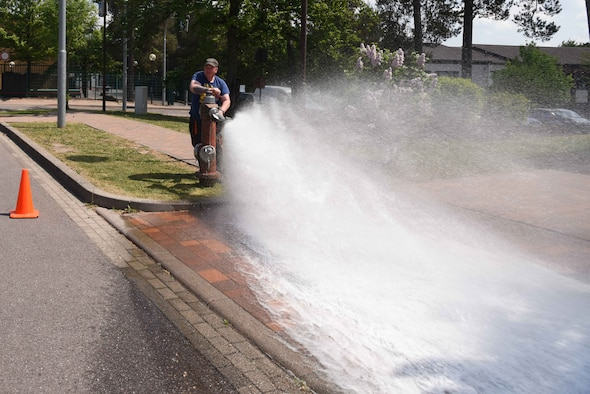 Thomas Bredel, water-plant mechanic, 786th CES, tests the water pressure of a fire hydrant on Ramstein Air Base, Germany, May, 9, 2018. Hydrant flow tests are conducted every spring.