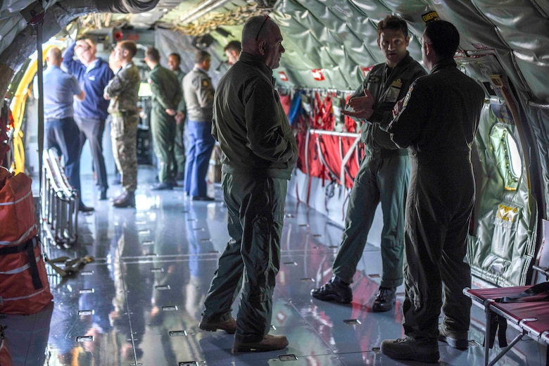 Aircrew from 13 NATO countries tour the KC-135 Stratotanker from the 100th Air Refueling Wing, during the European Tanker Symposium at RAF Mildenhall, England, May 14, 2018. At the end of the week-long event, aircrew flew in the KC-135, and Royal Air Force Voyager mixed formations. (U.S. Air Force photo by Senior Airman Christine Groening)