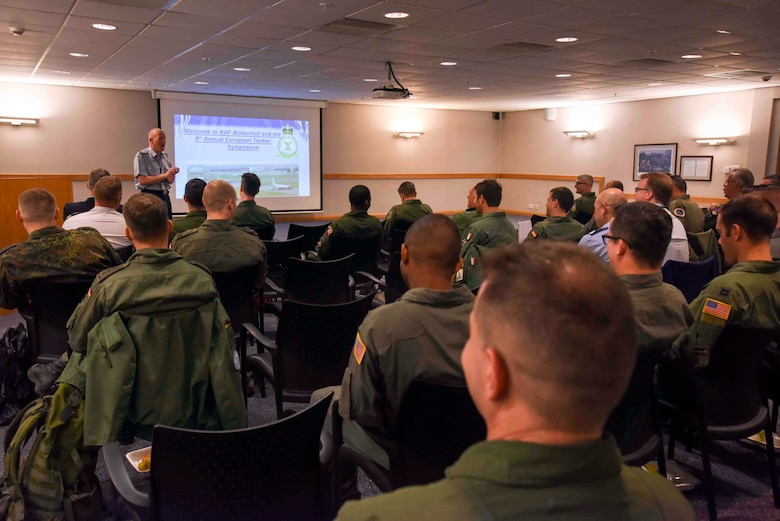 Sqn. Ldr. Richard Fryer, RAF Mildenhall station commander, welcomes aircrew on the first day of the European Tanker Symposium at RAF Mildenhall, England, May 14, 2018.  The 100th Air Refueling Wing hosted the 5th annual European Tanker Symposium, where 13 countries came together and trained to establish mixed-flight formation air refueling standardized procedures. (U.S. Air Force photo by Senior Airman Christine Groening)