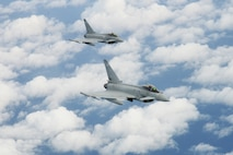 A pair of Royal Air Force Typhoon fighters fly over the North Sea May 17, 2018. The fighters received fuel from an RAF Voyager aircraft as part of the 5th annual European Tanker Symposium held on RAF Mildenhall, England. (U.S. Air Force photo by Tech. Sgt. David Dobrydney)