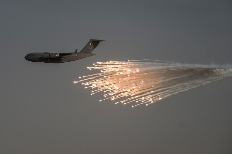 A Qatar Emiri Air Force C-17 Globemaster shoots flares during the Qatar Emiri Air Force Lahoub exercise at Al-Qalael drop zone, Qatar, May 9, 2018. The C-17 is able to operate on small, austere airfields previously limited to C-130s. The U.S. and Qatar work together to foster military cooperation to strengthen & expand contributions to the Coalition's fight against the Islamic State of Iraq and Syria. (U.S. Air Force photo by Staff Sgt. Corey Hook)