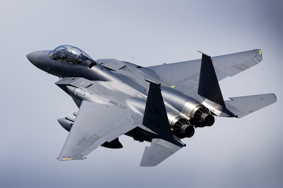An F-15E Strike Eagle assigned to the 492nd Fighter Squadron flies over Royal Air Force Lakenheath, England, May 10, 2018. The 492nd FS trains regularly to ensure RAF Lakenheath brings unique air combat capabilities to the fight. (U.S. Air Force photo by Tech. Sgt. Matthew Plew)