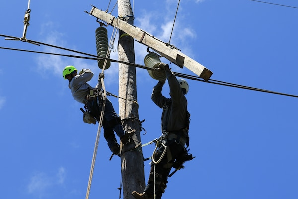 U.S. Army Corps of Engineers Task Force Power Restoration contractors complete work on a transmission line in the Guanica State Forest, Puerto Rico, April 6.