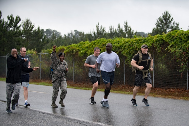 Members of the 23d Security Forces Squadron rush to the finish line of a Law Enforcement memorial 5k run and rucksack march, May 17, 2018, at Moody Air Force Base, Ga. President John F. Kennedy signed a proclamation in 1962 designating may 15 as Peace Officers Memorial Day.  Security Forces Members used Police Week to promote camaraderie and recognize all law enforcement members who have lost their lives in the line of duty. (U.S. Air Force photo by Senior Airman Daniel Snider)