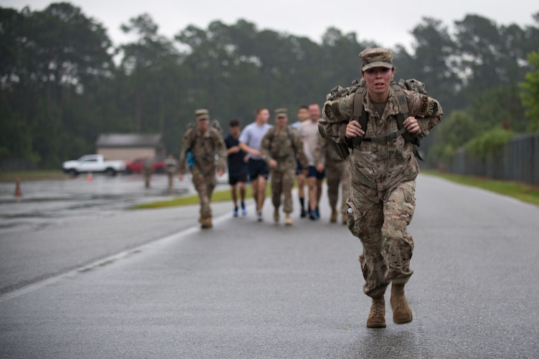 Staff Sgt. Elizabeth Patty, 820th command support staff member, carries her rucksack across the finish line of a Law Enforcement memorial 5k run and rucksack march, May 17, 2018, at Moody Air Force Base, Ga.Security Forces Members used Police Week to promote camaraderie and recognize all law enforcement members who have lost their lives in the line of duty. (U.S. Air Force photo by Senior Airman Daniel Snider)