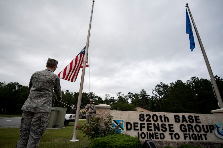 Airmen from the 23d Force Support Squadron base honor guard during the closing ceremony of National Police Week, May 18, 2018, at Moody Air Force Base, Ga. President John F. Kennedy signed a proclamation in 1962 designating may 15 as Peace Officers Memorial Day.  Security Forces Members used Police Week to promote camaraderie and recognize all law enforcement members who have lost their lives in the line of duty. (U.S. Air Force photo by Senior Airman Daniel Snider)