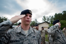 Senior Airman Michael Filipkowski, 23d Security Forces Squadron training instructor, renders a salute during the closing ceremony of National Police Week, May 18, 2018, at Moody Air Force Base, Ga. President John F. Kennedy signed a proclamation in 1962 designating may 15 as Peace Officers Memorial Day.  Security Forces Members used Police Week to promote camaraderie and recognize all law enforcement members who have lost their lives in the line of duty. (U.S. Air Force photo by Senior Airman Daniel Snider)