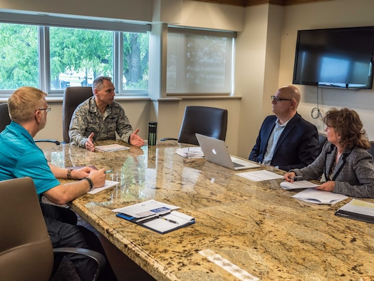 From left, Mike Sanford and Col. Tony Polashek meet with DoD stakeholders Salvadore Libretto and Cheryl Loft during Phase 1 of the BHMC Pilot May 17. (Air Force Photo/Paul Zadach)