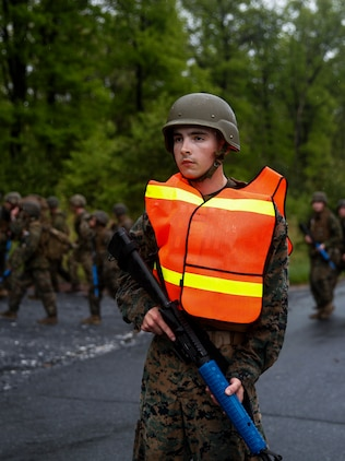 U.S. Marine Private First Class Cody A. Evans, combat engineer with Engineer Company C, 6th Engineer Support Battalion, 4th Marine Logistics Group, posts as a road guard during a five mile hike with Marines with 6th ESB, 4th MLG, and British commando's with 131 Commando Squadron Royal Engineers, British Army, during exercise Red Dagger at Fort Indiantown Gap, Pa., May 17, 2018.