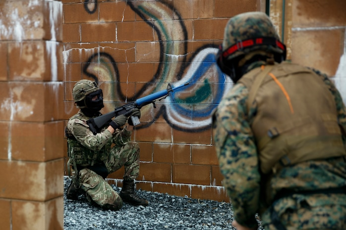 British Army Cpl. Thomas Matthews, commando with 131 Commando Squadron Royal Engineers, British Army,  sets security for his platoon of Marines with 6th ESB, 4th MLG and British commando's with 131 Commando Squadron Royal Engineers, British Army, during a simulated live scenario at the military operations on urbanized terrain, or MOUT structure, during exercise Red Dagger at Fort Indiantown Gap, Pa., May 17, 2018.