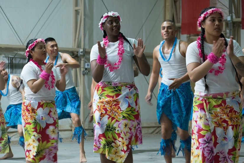 American Soldiers perform traditional dances at an Asian American, Pacific Islander cultural observance at Camp Buehring, Kuwait, May 12, 2018. The dancers performed primarily Polynesian dances during the cultural observance, which was held to celebrate the contributions of Pacific Islanders and Asian Americans and to raise awareness of Asian heritage among personnel on the installation. A similar event is scheduled for Camp Arifjan, Kuwait, on May 26.