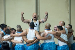 Staff Sgt. Latu P. Halafihi, 40th Composite Supply Company, 541st Combat Sustainment Support Battalion, leads a traditional dance with other American Soldiers at an Asian American, Pacific Islander cultural observance at Camp Buehring, Kuwait, May 12, 2018. The dancers performed primarily Polynesian dances during the cultural observance, which was held to celebrate the contributions of Pacific Islanders and Asian Americans and to raise awareness of Asian heritage among personnel on the installation. A similar event is scheduled for Camp Arifjan, Kuwait, on May 26.