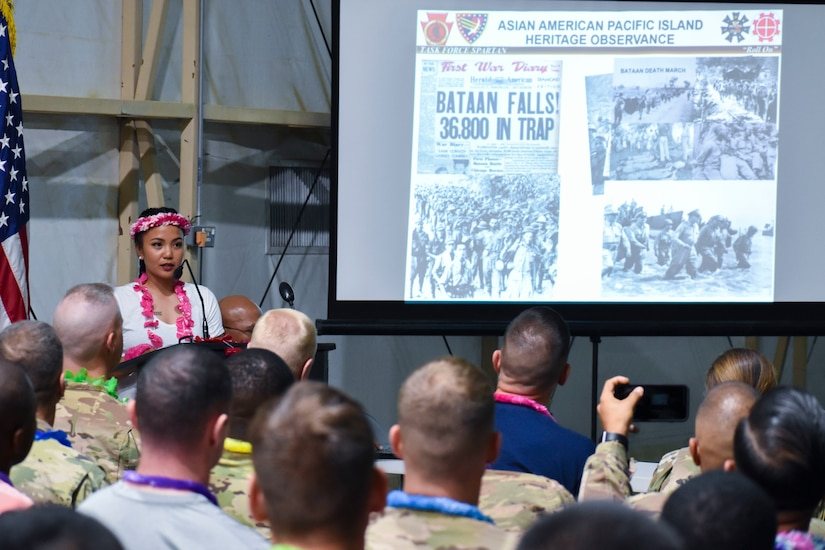 Sgt. Kristal V. Baradi, 40th Composite Supply Company, 541st Combat Support Sustainment Battalion, speaks about Philippine history at an Asian American, Pacific Islander cultural observance at Camp Buehring, Kuwait, May 12, 2018. Baradi focused on the islands experiences from Europeans arriving at the nation through World War II and Filipino independence at the cultural observance, which was held to celebrate the contributions of Pacific Islanders and Asian Americans and to raise awareness of Asian heritage among personnel on the installation. A similar event is scheduled for Camp Arifjan, Kuwait, on May 26.