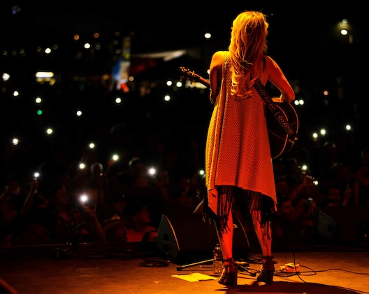 Jennifer Wayne, a musical artist with the band Runaway June, performs at the 15th annual We Salute You Celebration aboard the Marine Corps Air Ground Combat Center, Twentynine Palms, Calif., May 12, 2018. The annual event is held to thank military members aboard the Combat Center for their service and featured a free live music concert, games, activities, food and beverages. (U.S. Marine Corps photo by Lance Cpl. Rachel K. Porter)