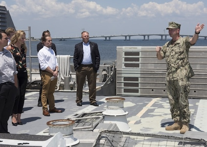 Naval Engineering and Education Consortium college students listen to Senior Chief Petty Officer Josh Pearsall, assigned to Assault Craft Unit FOUR Detachment Panama City, explains the mission and science behind landing craft air cushions during a visit to Naval Surface Warfare Center Panama City Division May 10, 2018. (RELEASED) U.S. Navy photo by Ronnie Newsome, NSWC PCD.