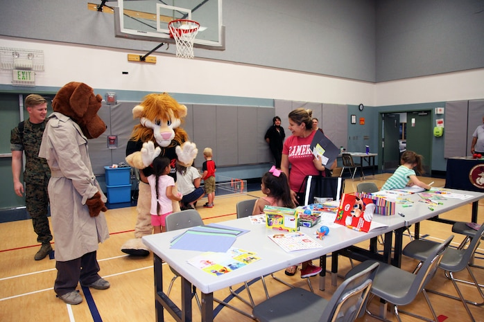 McGruff the Crime Dog and Daren the DARE Lion interact with family members attending the Combat Center School Liaison's annual Kindergarten Parent Transition Workshop, May 9, 2018. The event at the MCCS Community Center aboard Marine Corps Air Ground Combat Center, Twentynine Palms, Calif., drew 38 parents and 32 children. (U.S. Marine Corps photo by Kelly O'Sullivan)