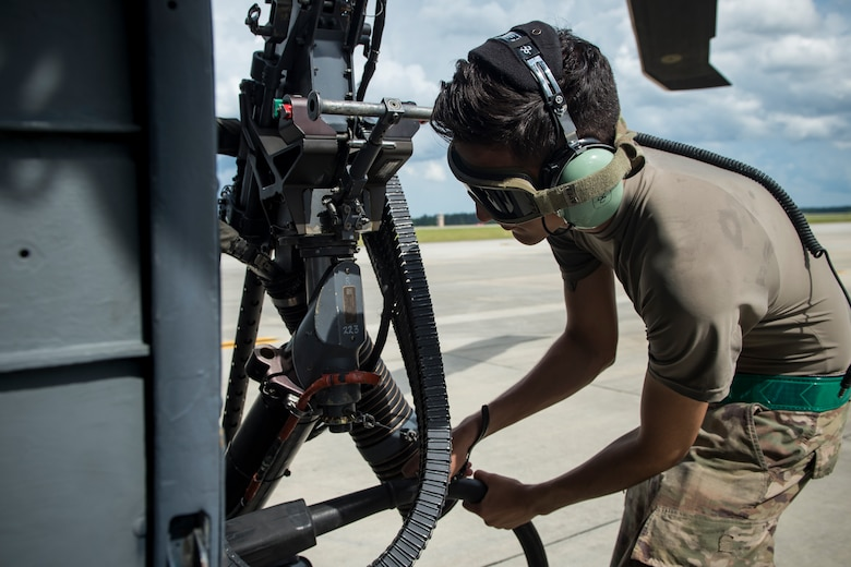 Airman 1st Class Brendan Alicea, 723d Aircraft Maintenance Squadron crew chief, detaches a cord from an HH-60G Pave Hawk prior to flight, May 17, 2018, at Moody Air Force Base, Ga. Airmen conduct routine training missions in the airspace surrounding Moody to remain current on their tactics and procedures. While helping pilots remain proficient, training also gives crew chiefs and maintainers the opportunity to remain proficient at launching and maintaining the aircraft. (U.S. Air Force photo by Senior Airman Janiqua P. Robinson)