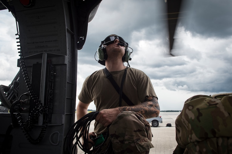 Airman 1st Class Joshua Costello, 723d Aircraft Maintenance Squadron crew chief, watches the propellers of an HH-60G Pave Hawk rotate prior to launching the aircraft, May 17, 2018, at Moody Air Force Base, Ga. Airmen conduct routine training missions in the airspace surrounding Moody to remain current on their tactics and procedures. While helping pilots remain proficient, training also gives crew chiefs and maintainers the opportunity to remain proficient at launching and maintaining the aircraft. (U.S. Air Force photo by Senior Airman Janiqua P. Robinson)