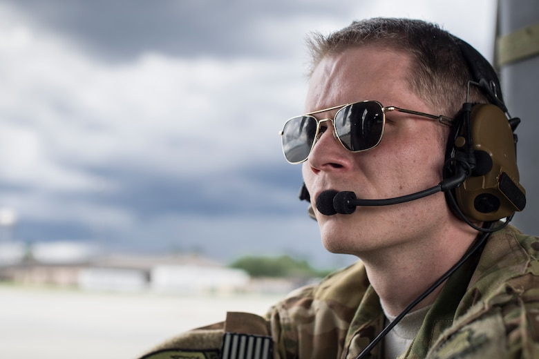 Senior Airman Ethan Aarness, 41st Rescue Squadron special missions aviator, watches a preflight inspection before a HH-60G Pave Hawk launch May 17, 2018, at Moody Air Force Base, Ga. Airmen conduct routine training missions in the airspace surrounding Moody to remain current on their tactics and procedures. While helping pilots remain proficient, training also gives crew chiefs and maintainers the opportunity to remain proficient at launching and maintaining the aircraft. (U.S. Air Force photo by Senior Airman Janiqua P. Robinson)