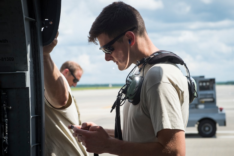 Senior Airman Derek Fischer, 723d Aircraft Maintenance Squadron maintenance specialist, checks a technical order while performing a preflight systems check, May 17, 2018, at Moody Air Force Base, Ga. Airmen conduct routine training missions in the airspace surrounding Moody to remain current on their tactics and procedures. While helping pilots remain proficient, training also gives crew chiefs and maintainers the opportunity to remain proficient at launching and maintaining the aircraft. (U.S. Air Force photo by Senior Airman Janiqua P. Robinson)