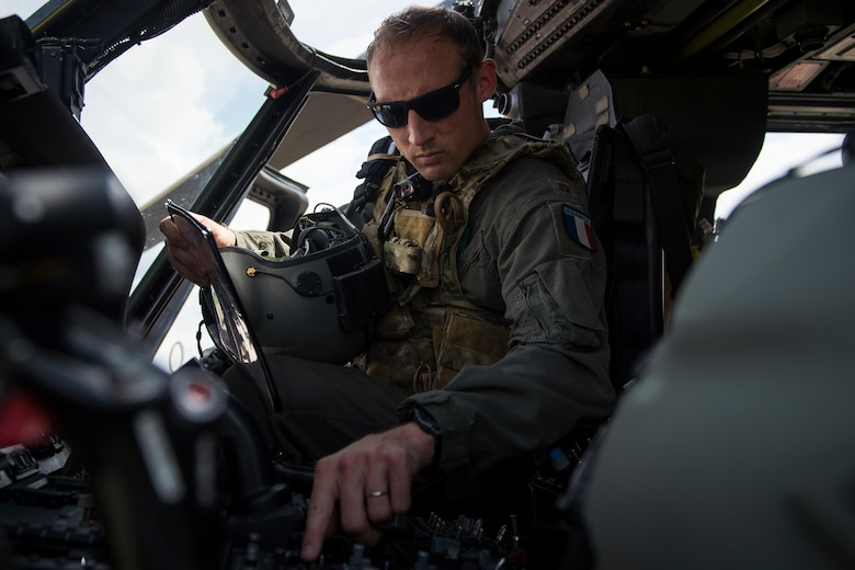Commandant Micka, a French exchange pilot and assistant director of operations for Moody's 41st Rescue Squadron, performs a preflight systems check prior to flying an HH-60G Pave Hawk, May 17, 2018, at Moody Air Force Base, Ga. Airmen conduct routine training missions in the airspace surrounding Moody to remain current on their tactics and procedures. While helping pilots remain proficient, training also gives crew chiefs and maintainers the opportunity to remain proficient at launching and maintaining the aircraft. (U.S. Air Force photo by Senior Airman Janiqua P. Robinson)