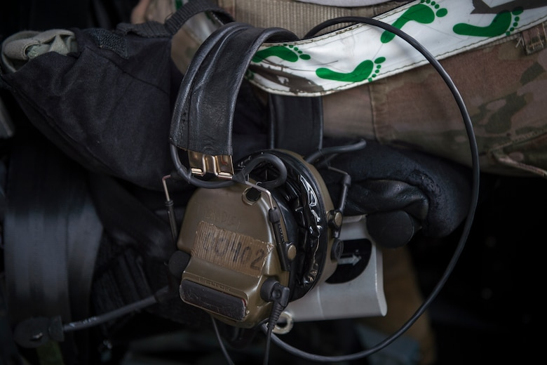A headset hangs from an Airman's reflective belt, May 17, 2018, at Moody Air Force Base, Ga. While helping pilots remain proficient, training also gives crew chiefs and maintainers the opportunity to remain proficient at launching and maintaining the aircraft. (U.S. Air Force photo by Senior Airman Janiqua P. Robinson)