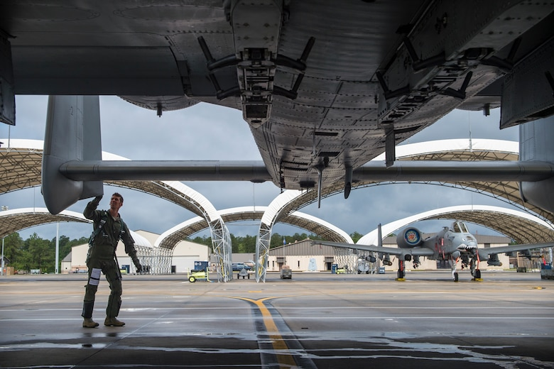 Lt. Col. Jeremy Johnston, 23d Fighter Group A-10C Thunderbolt II pilot, checks the vertical stabilizer prior to flying, May 17, 2018, at Moody Air Force Base, Ga. Airmen conduct routine training missions in the airspace surrounding Moody to remain current on their tactics and procedures. While helping pilots remain proficient, training also gives crew chiefs and maintainers the opportunity to remain proficient at launching and maintaining the aircraft. (U.S. Air Force photo by Senior Airman Janiqua P. Robinson)