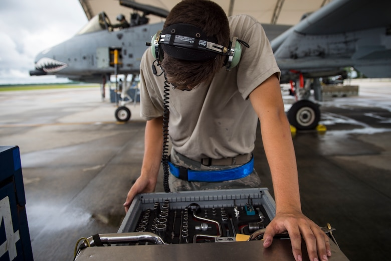 Airman 1st Class Jacob Curry, 23d Aircraft Maintenance Squadron crew chief, inspects his tools prior to launching an A-10C Thunderbolt II, May 17, 2018, at Moody Air Force Base, Ga. Airmen conduct routine training missions in the airspace surrounding Moody to remain current on their tactics and procedures. While helping pilots remain proficient, training also gives crew chiefs and maintainers the opportunity to remain proficient at launching and maintaining the aircraft. (U.S. Air Force photo by Senior Airman Janiqua P. Robinson)