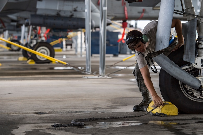 Airman 1st Class Jacob Curry, 23d Aircraft Maintenance Squadron crew chief, removes a chalk prior to launching an A-10C Thunderbolt II, May 17, 2018, at Moody Air Force Base, Ga. Airmen conduct routine training missions in the airspace surrounding Moody to remain current on their tactics and procedures. While helping pilots remain proficient, training also gives crew chiefs and maintainers the opportunity to remain proficient at launching and maintaining the aircraft. (U.S. Air Force photo by Senior Airman Janiqua P. Robinson)