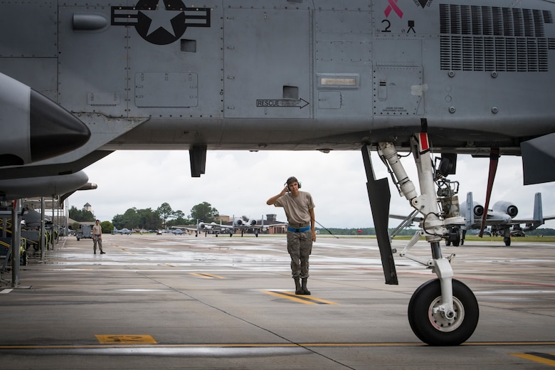 Airman 1st Class Jacob Curry, 23d Aircraft Maintenance Squadron crew chief, salutes a pilot while launching an A-10C Thunderbolt II, May 17, 2018, at Moody Air Force Base, Ga. Airmen conduct routine training missions in the airspace surrounding Moody to remain current on their tactics and procedures. While helping pilots remain proficient, training also gives crew chiefs and maintainers the opportunity to remain proficient at launching and maintaining the aircraft. (U.S. Air Force photo by Senior Airman Janiqua P. Robinson)